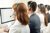 Back view of Asian telemarketing customer service agent team, call center job concept