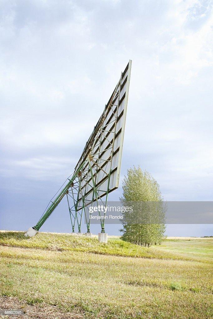 Back view of billboard in rural grassland : Stock Photo