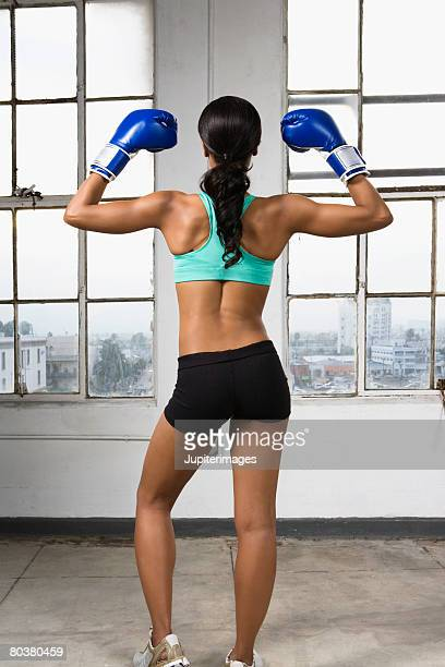 Back view of boxer flexing muscles