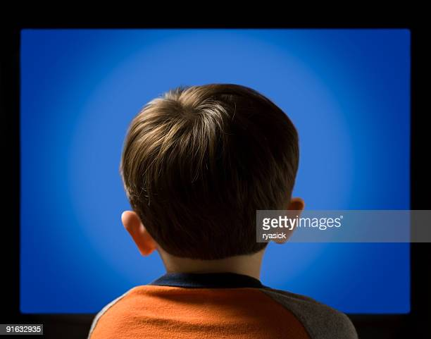 Back View of Child Against a Blue Monitor Computer Screen