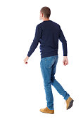 Back view of going  handsome man. walking young guy . Rear view people collection.  backside view of person.  Isolated over white background. A guy in a black sweater passes.