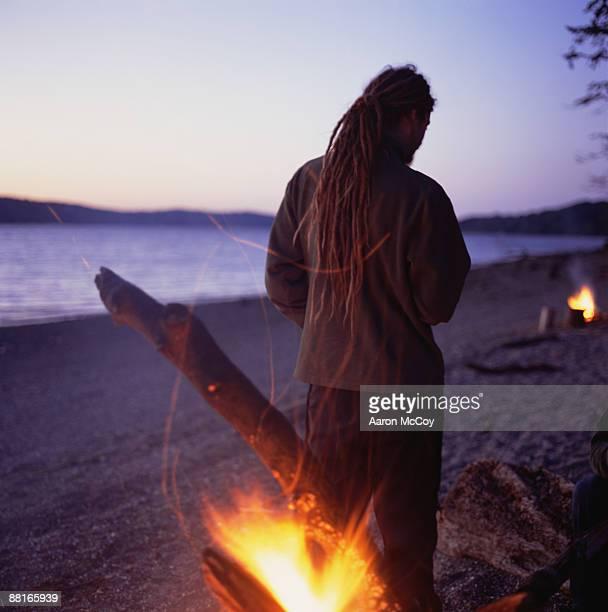 Back view of man near bonfire