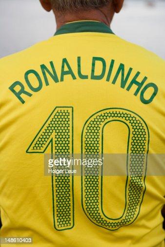 Back view of man wearing number 10 Ronaldinho Brazilian national soccer team football jersey.