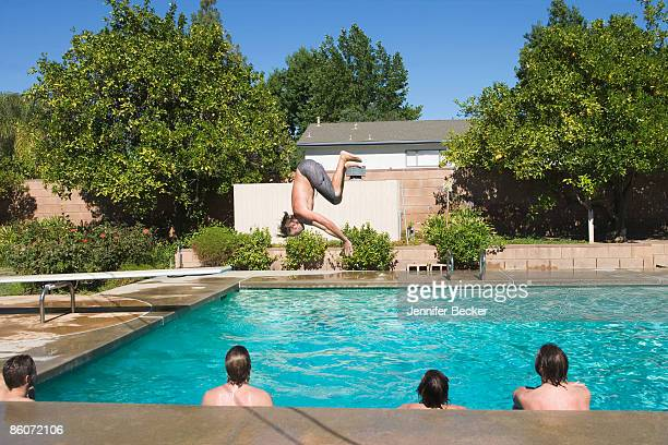 Back view of men in swimming pool