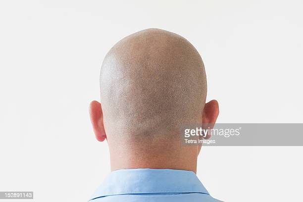 Back view of shaved businessman