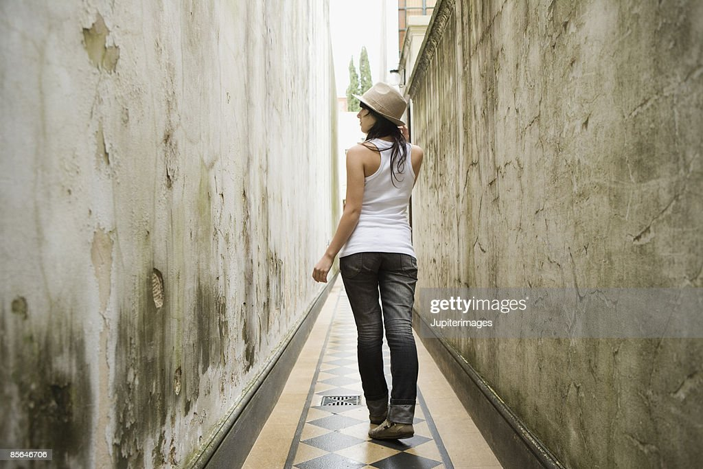 Back view of teenage girl in corridor : Stock Photo