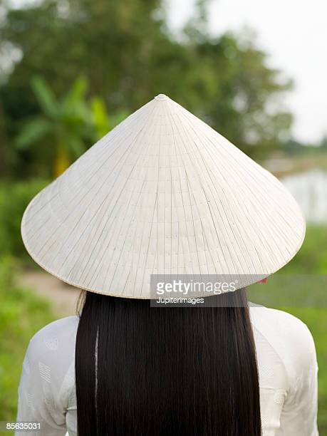 Back view of woman wearing straw hat, Vietnam