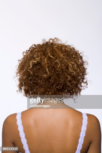 Back View Of Woman With Curly Hair Stock Photo Thinkstock