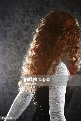Back View Of Woman With Curly Red Hair In Corset Stock ...