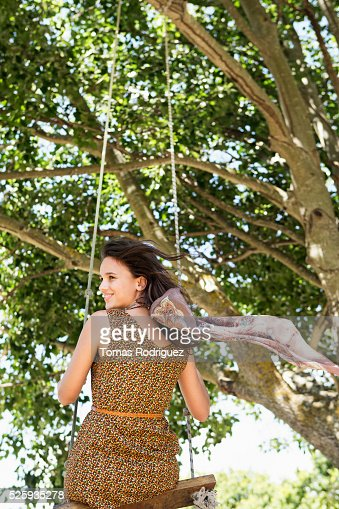 Back view of young woman on swing : Stock-Foto