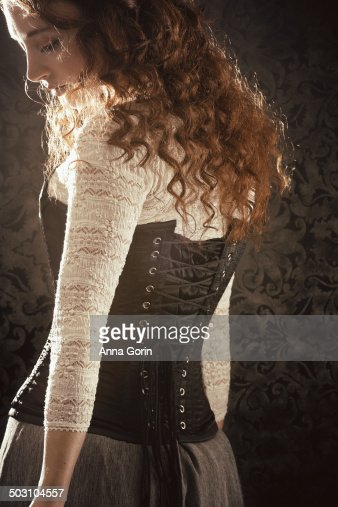 Back View Of Young Woman With Curly Hair In Corset Stock ...