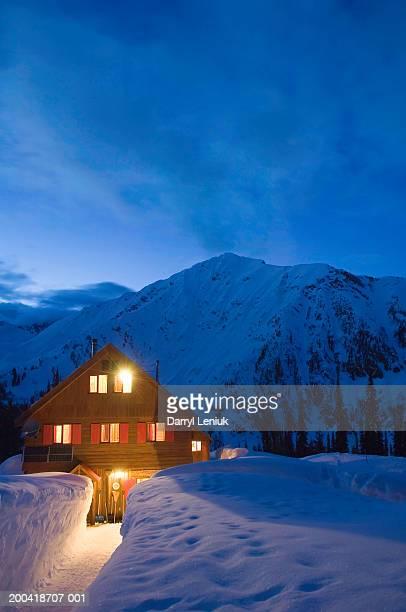 Backcountry ski lodge illuminated at dusk
