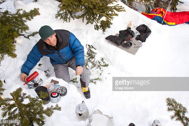 A backcountry skier cooking in Glacier National Park, Montana.
