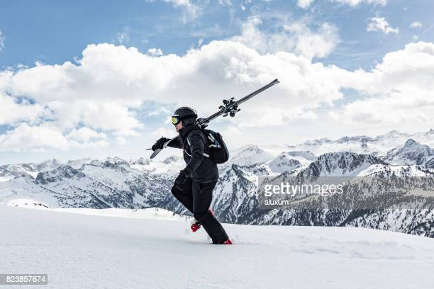 Backcountry skier hiking up mountain