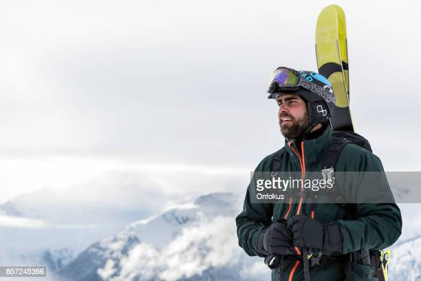 Backcountry Skier on Mountain Summit