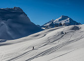 backcountry skiershead up towards Ptarmigan Ridge near Mt. Baker