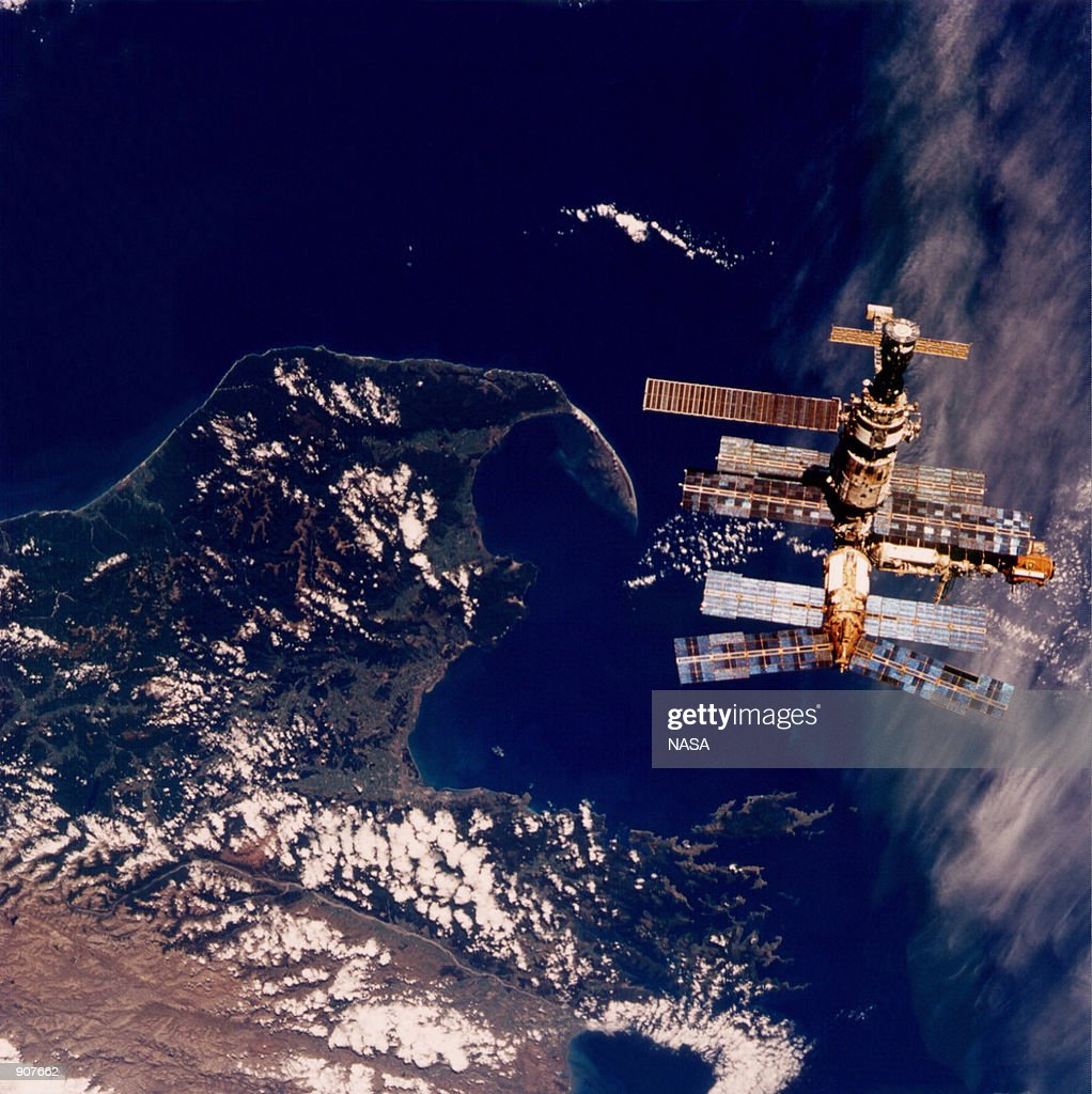 Backdropped against the waters of Cook Strait near New Zealand's South Island Russia's Mir space station is viewed from the flight deck of the Space...