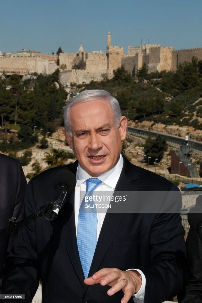 Backdropped by Jerusalem's Old City walls, Israeli Prime Minister Benjamin Netanyahu speaks to the press during a visit to the Begin Heritage center on January 21, 2013. With less than 24 hours until Israelis vote in general elections, party leaders were campaigning down to the wire ahead of a ballot seen returning Netanyahu to office. AFP PHOTO/GALI TIBBON