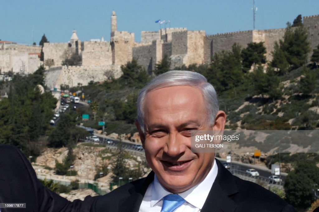 Backdropped by Jerusalem's Old City walls, Israeli Prime Minister Benjamin Netanyahu speaks to the press during a visit to the Begin Heritage center on January 21, 2013. With less than 24 hours until Israelis vote in general elections, party leaders were campaigning down to the wire ahead of a ballot seen returning Netanyahu to office.