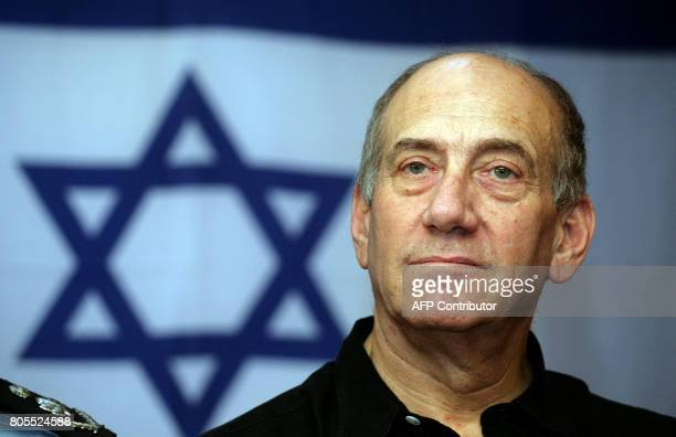Backdropped by the national flag Israeli Prime Minister Ehud Olmert is seen at his Sukkah on the occasion of the Jewish holiday of Sukkot or the...