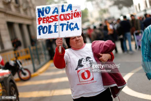 A backer expresses her support to former Peruvian President Ollanta Humala as the vehicle transporting him and his wife Nadine Heredia leaves toward...