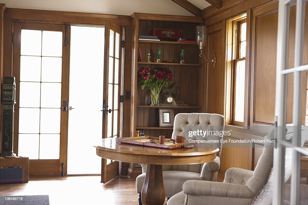 Backgammon set on table in living room : Stock Photo