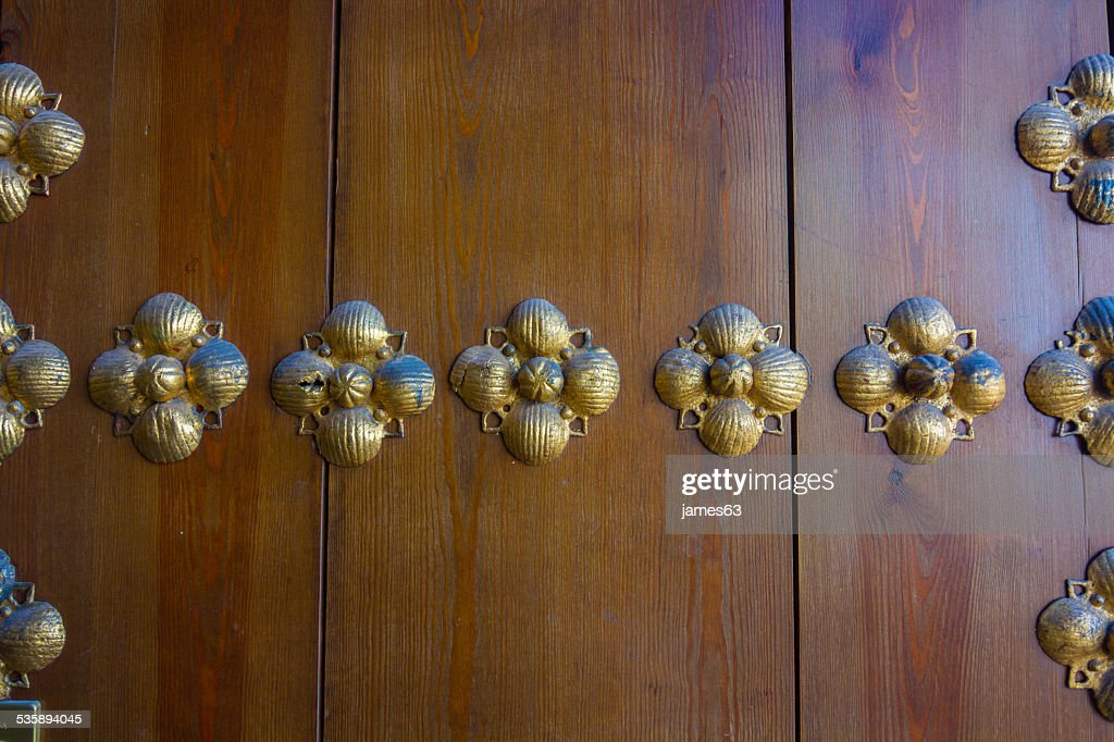 background brass hardware on old wooden door : Stock Photo
