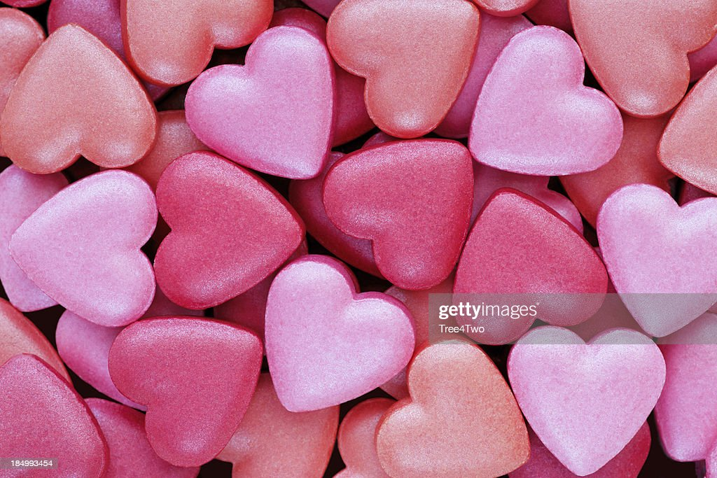 'Background: Colorful, heart shaped candies'