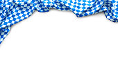Background for Oktoberfest with bavarian white and blue fabric isolated on white