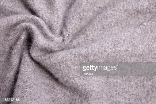 A background image of a grey cashmere blanket or sweater