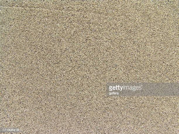 Background image of flat speckled tan sand