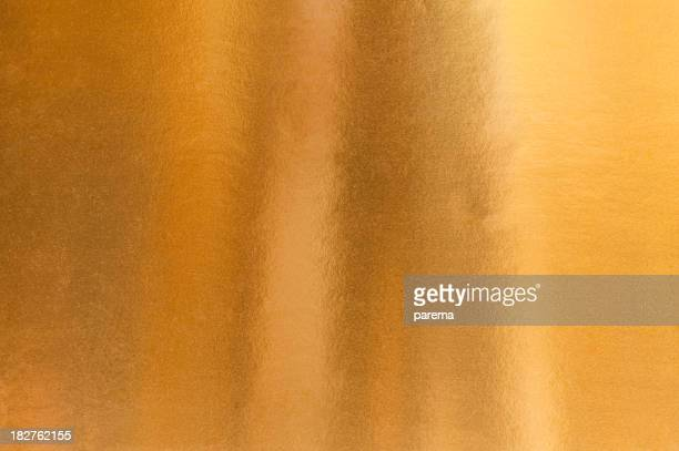 A background image of gold paper