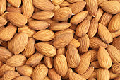 Food background - big shelled almonds situated arbitrarily