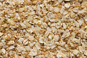 background of a mixture of rice, oat, buckwheat flakes and linseeds on a plate. Super food for healthy eating and diet.