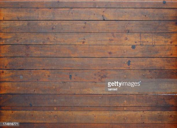 Background of a ship's knotted wooden deck flooring