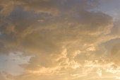 Cloudscape background with golden light of sunset