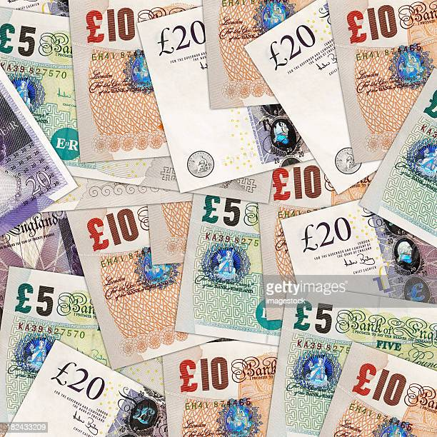 A background of different British pounds