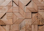 abstract background of geometric wood pieces.