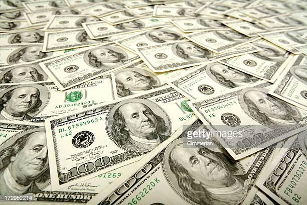 Background of layered crisp US one hundred dollar bills