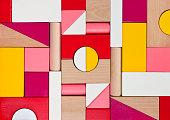 Background of multicolor wooden children toy blocks