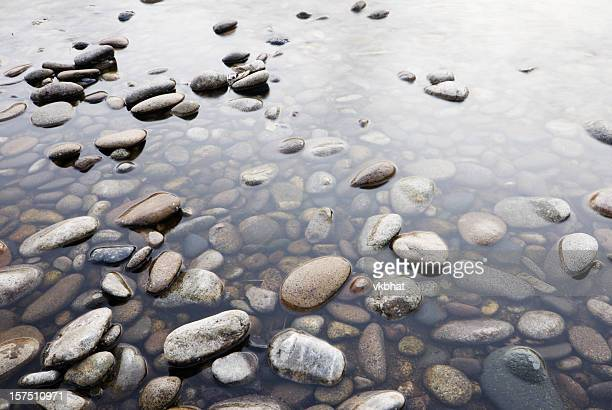 Background of pebbles in shallow water
