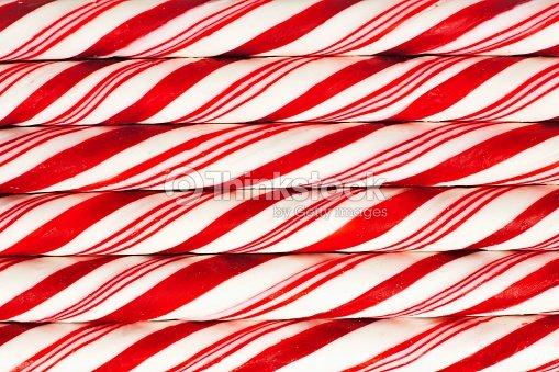 Sfondo Di Rosso E Bianco A Righe Bastoncini Di Zucchero Foto Stock