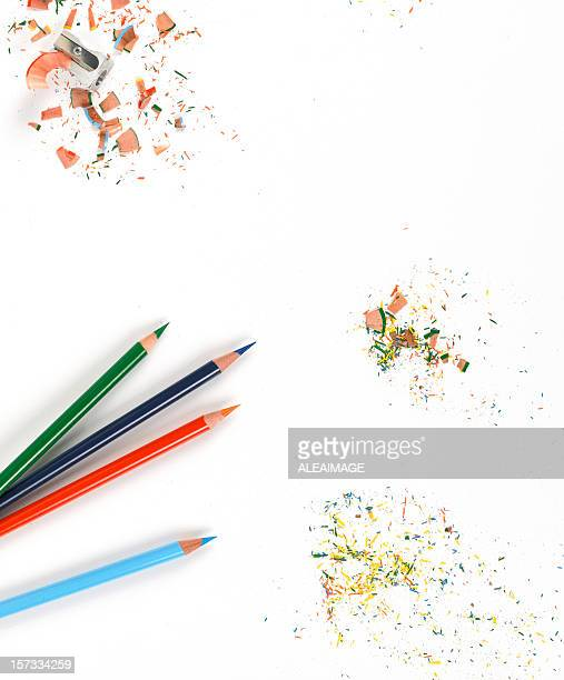 Background of Sharp colored pencils and shavings on white