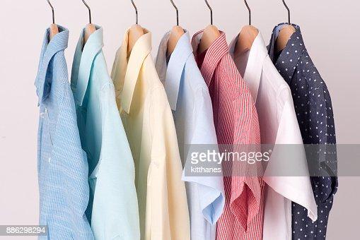 background of shirts hanging on hanger : Stock Photo