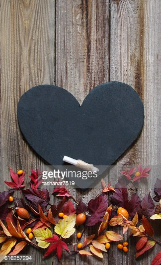 Background with autumn leaves, slate heart and chalk : Stock Photo