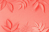 Background with leaves, Living Coral color, copy space