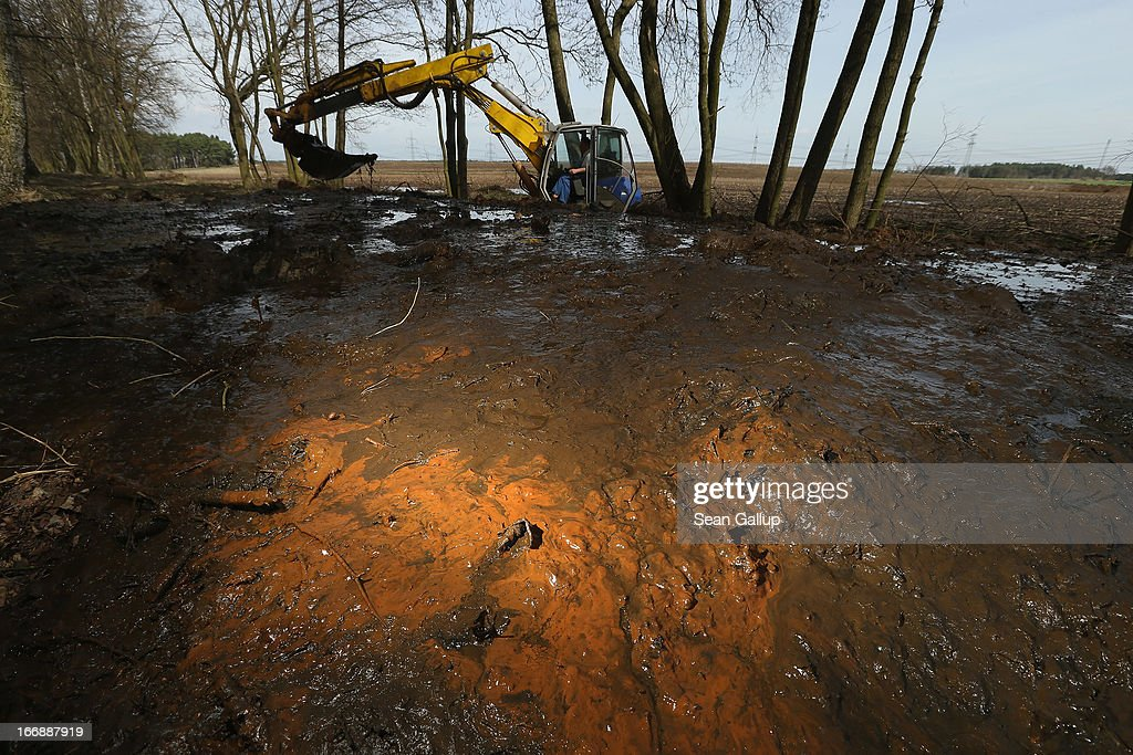 A backhoe digs mud rich in iron sediment out of the Wudritz creek in the Spreewald region on April 17, 2013 near Luebbenau, Germany. The Wudritz is heavily burdened with iron from the nearby former Schlabendorf open pit coal mine, which has since been turned into a lake called the Schlabendorfer See. Many creeks and small rivers that feed the Spree River have turned a rich orange or brown, sometimes even red, due to the sediments flowing from several former open pit coal mines. The Spreewald is a popular tourist destination known for its network of canals and local tour operators fear the sediment will turn the waters there orange as well, which could seriously impact the tourist seasons. Though the iron sediment is not poisonous, some local farmers claim they have been forced to filter the water they use to irrigate their fields, and many people report the disappearance of fish and other fauna.