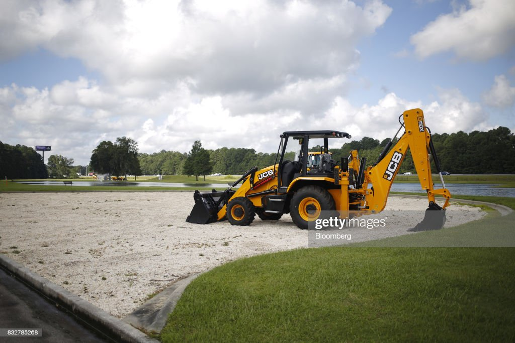 A JCB backhoe excavator is displayed outside the JCB North America manufacturing plant in Pooler, Georgia, U.S., on Friday, Aug. 11, 2017. Photographer: Luke Sharrett/Bloomberg via Getty ImagesThe Federal Reserve is scheduled to release industrial production figures on August 17. Photographer: Luke Sharrett/Bloomberg via Getty Images
