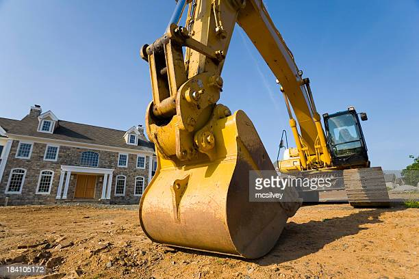 Backhoe in Front Yard