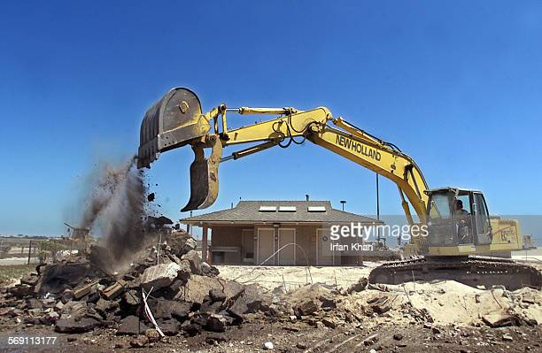 A backhoe makes the way for the new structures to come up on Bolsa Chica State Beach as a part of 2 million renovation project
